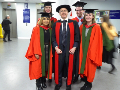 Photograph of Mark with Maryam, Amy, Chris, and Sarah on their graduation January 14, 2016.